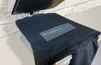 Heat press machine transferring the design on to a t-shirt